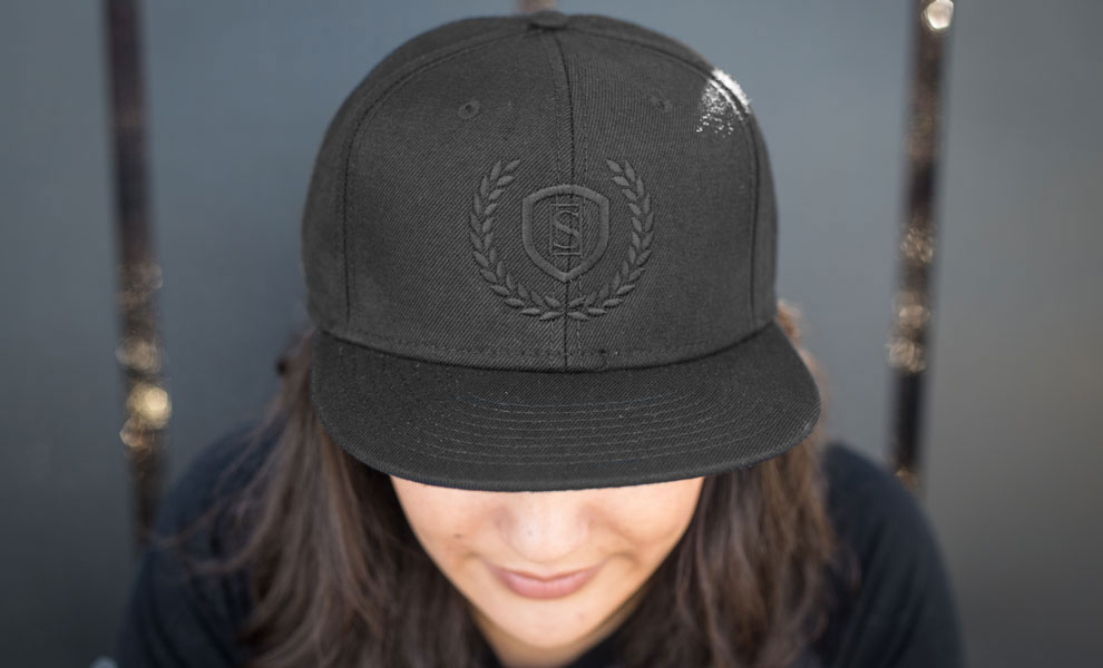 Gallery Feature Image of Sideshow Black Snapback Cap Apparel - Click to open image gallery