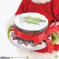 Gallery Image of Grinch Fruitcake Figurine