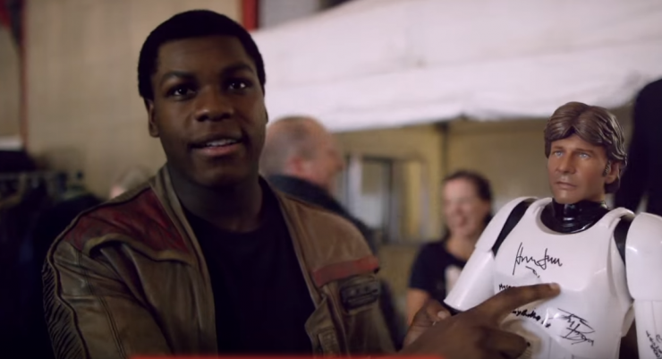 Harrison Ford autographs Han Solo action figure for his new bestie John Boyega