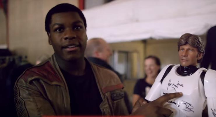 Harrison Ford autographs Han Solo action figure for his new bestie John Boyega
