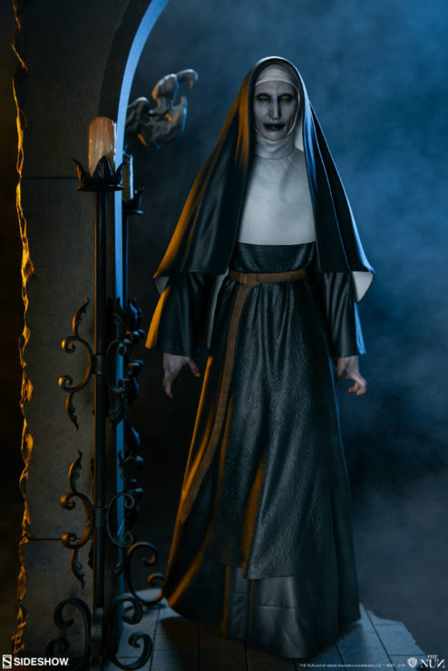 Dramatic Lit Image of The Nun Statue from the Conjuring Universe
