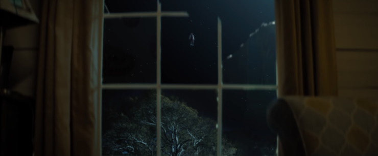 Brightburn flying outside a shattered window