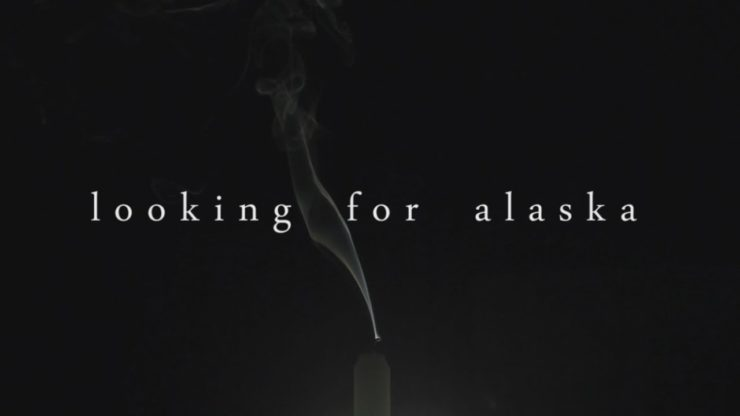 looking for alaska written on a black background with cigarette smoke rising behind it