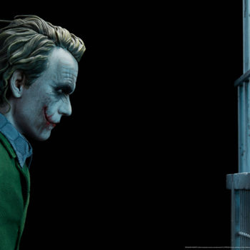 The Joker Premium Format™ Figure Portrait in Profile, staring at Jail Cell Bars