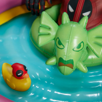 Kidpool Premium Format™ Figure Fin Fang Foom Floatie and Rubber Duckpool Close Up