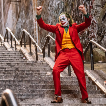 The Joker dancing down a staircase