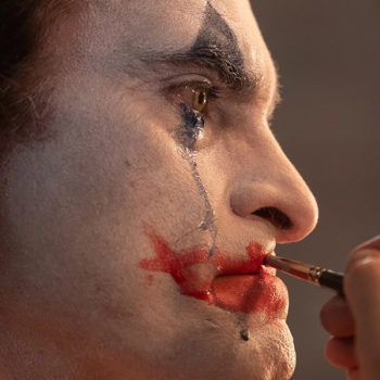 Arthur Fleck crying and putting on his iconic makeup for The Joker