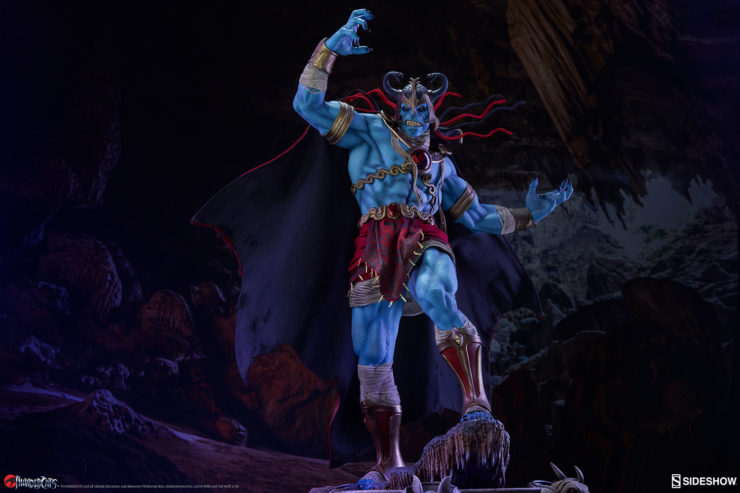 mumm-ra thundercats statue by sideshow standing in a dark carve with his claws curled in the air
