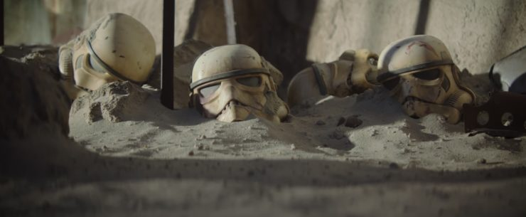 Clone trooper helmets stabbed into the ground