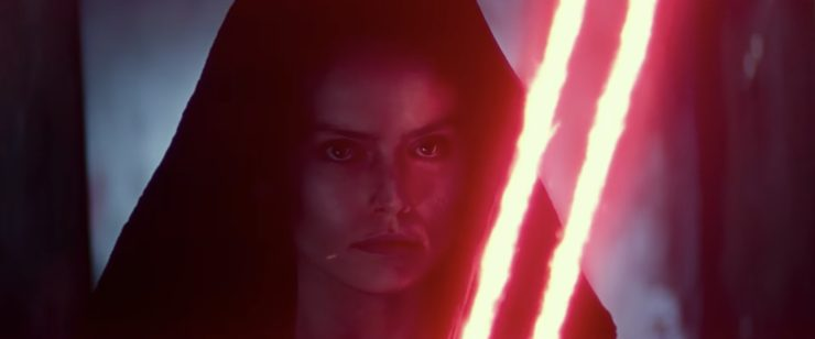 Rey wiedling a dual-bladed red lightsaber