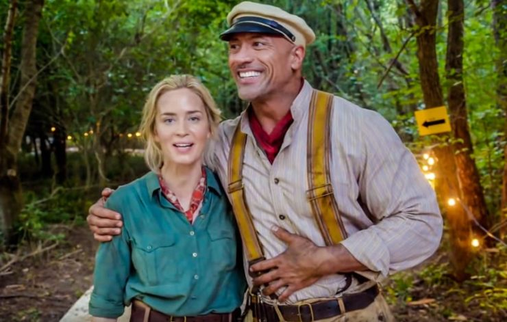 Jungle Cruise Dwayne Johnson and Emily Blunt embracing on set