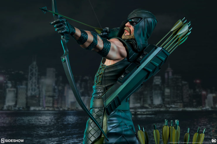 Green Arrow drawing his bow turning over his left shoulder