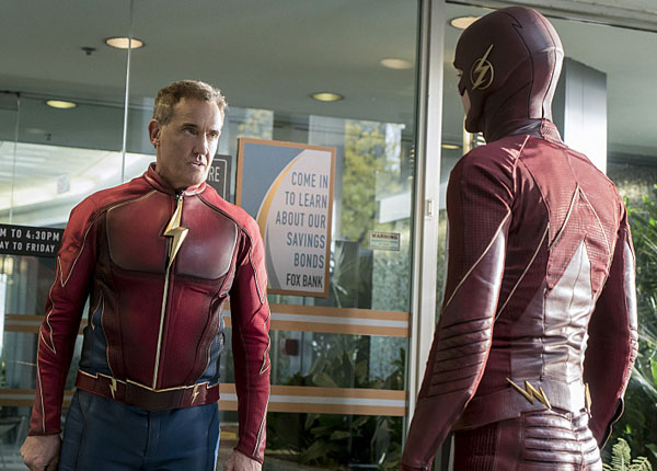John Wesley Shipp as Jay Garrick talking to Barry Allen the flash