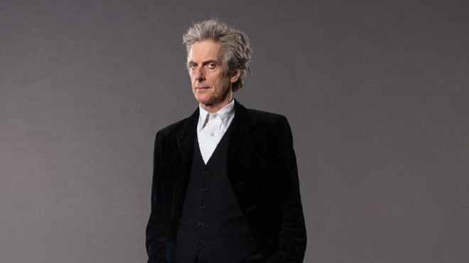 Peter Capaldi over a grey background