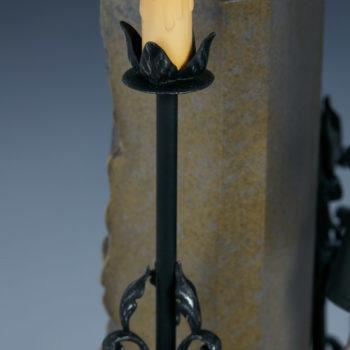 the nun statue candle closeup