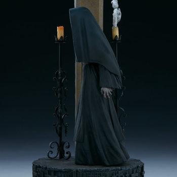 The Nun emerging from an ouroboros portal left view