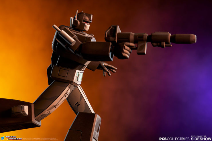 Nemesis Prime Classic Scale Statue by PCS Collectibles with Dramatic Lighting 4