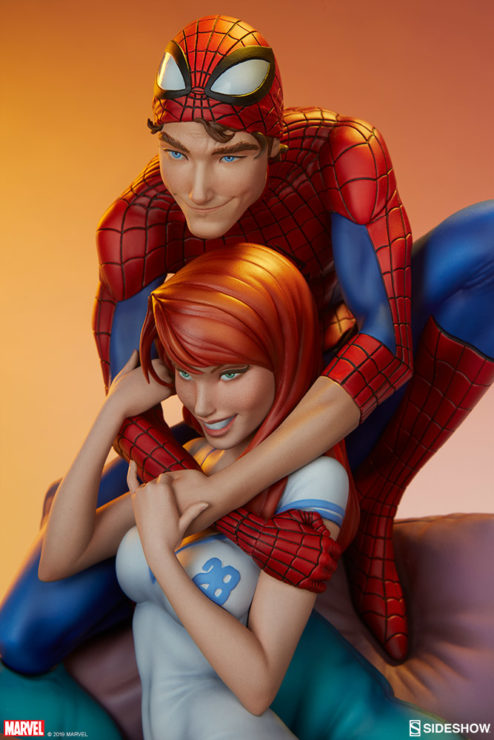 Spider-Man and Mary Jane Maquette Close up on Figures with Orange Background