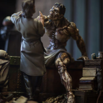 Bernie Wrightson Sideshow Sculpture showing the Daemon as Dr. Frankenstein is caught in his grasp
