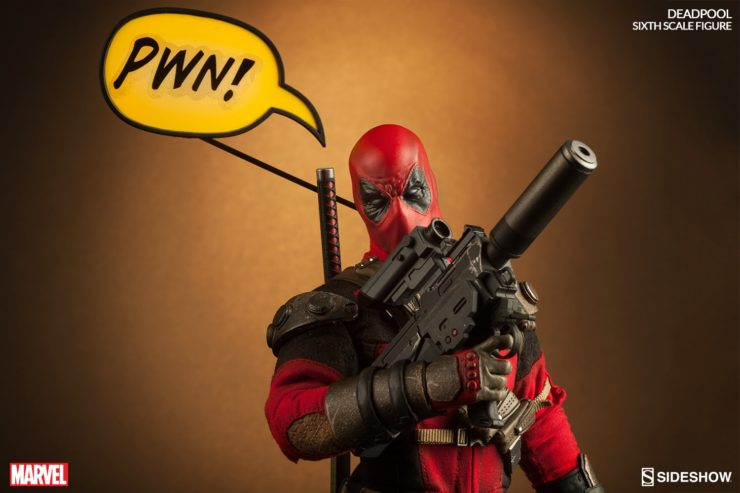"Deadpool holding a large gun with a talk bubble saying ""PWN!"""
