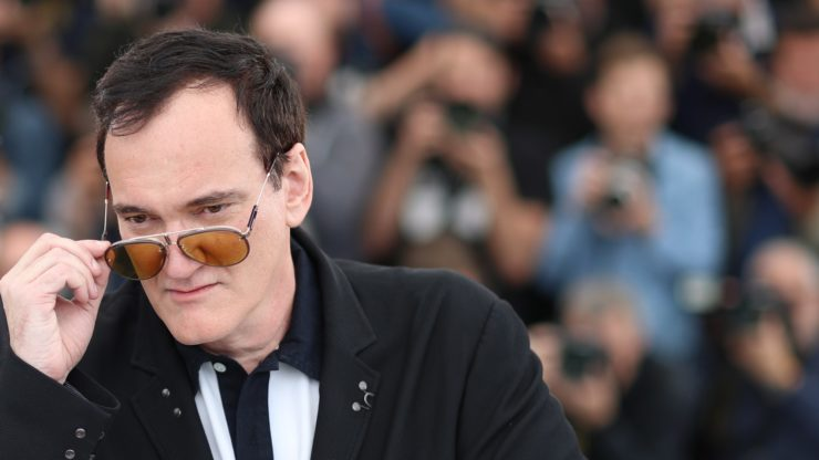 Quentin Tarantino wearing sunglasses at a premiere of one of his movies