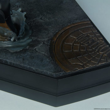 Close up on a Metropolis manhole cover on the Superman Call To Action Premium Format Figure