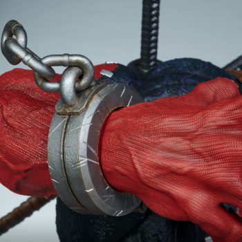 closeup of Venompool's right hand, with chain on wrist