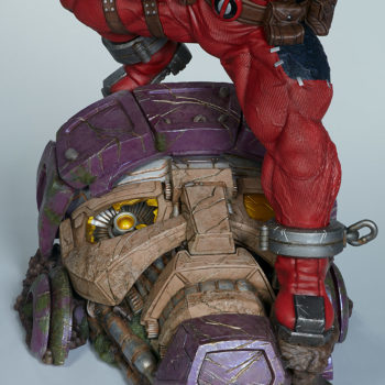 Looking up at the Sentinel's head from its chin, as Deadpool stands on top