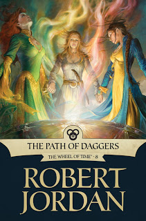 Wheel of Time book cover for the path of daggers, showing three woman working together standing around some magical energy in long flowing gowns