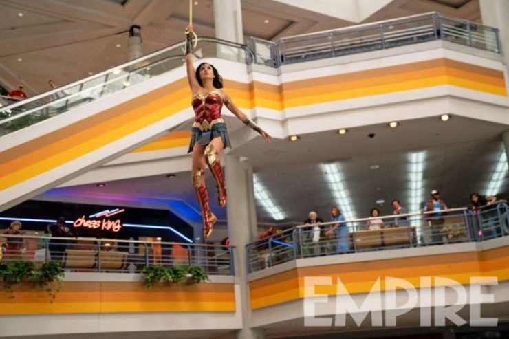 Wonder Woman swinging from her lasso through an 80s mall