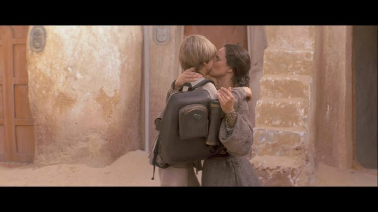 Pernilla August as Shmi Skywalker and Jake Lloyd as Anakin Skywalker in Star Wars: The Phantom Menace (1999)