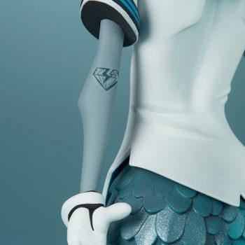Canary Blu Designer Toy close up on broken diamond tattoo on left elbow