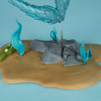 Canary Blu Designer Toy close up on rocky and seaweed base