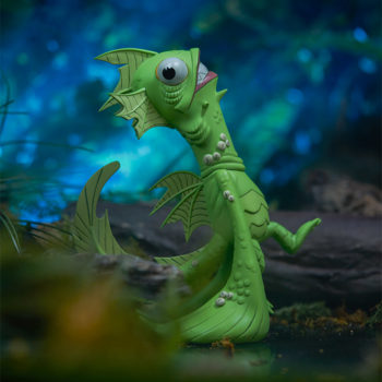 Fish Face Designer Toy right side view in marshy swamp with light flickering down