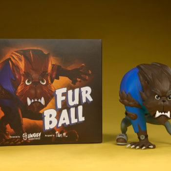 Fur Ball designer toy next to his box