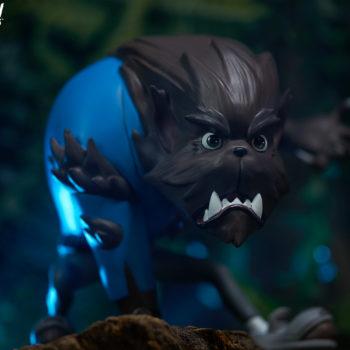 Fur Ball designer toy slight right view in dark woods