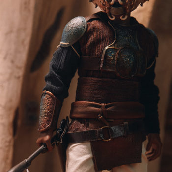 Lando Calrissian Skiff Guard Version Sixth Scale Figure with buildings in the background