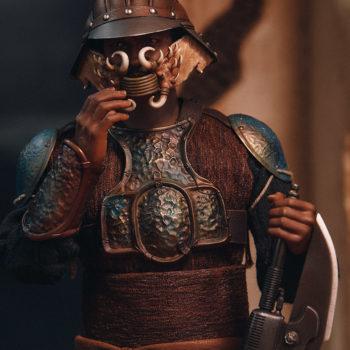 Lando Calrissian Skiff Guard Version Sixth Scale Figure preparing to take off helmet
