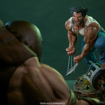 Logan Premium Format Figure toe to toe with the Juggernaut Maquette over shoulder view