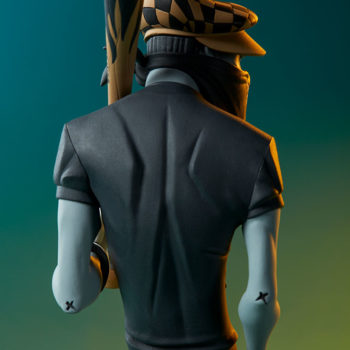 Smiles Designer Toy back view over green and yellow gradient background