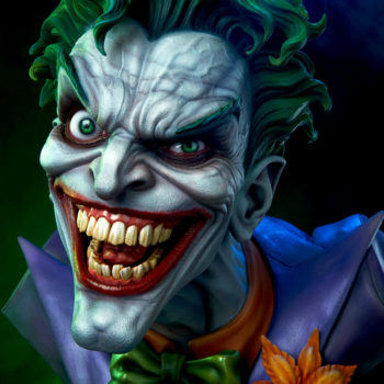 close up on the smile of The Joker Life-Size Bust with purple lights in the background