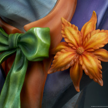 close up on orange flower and green bowtie of The Joker Life-Size Bust
