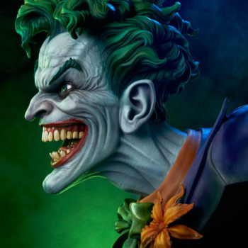 left size view of The Joker Life-Size Bust with green and purple lights behind it