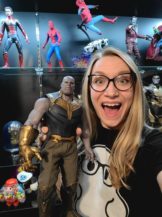 Heather Gast smiles with her Thanos 1:6