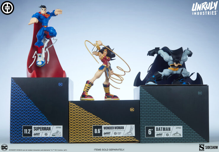 Wonder Woman Designer Collectible Toyby Artist Tracy Tubera next to Batman and Superman Designer Collectible Toys