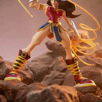 Wonder Woman Designer Collectible Toyby Artist Tracy Tubera Looking Up as she stands on the rocks