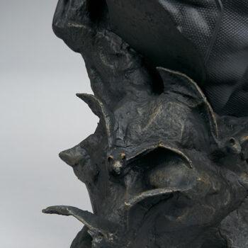 close up on bats on base of Batman Bust