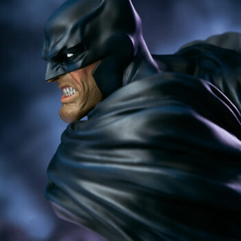 close up on left side of face of Batman Bust with smoke in background