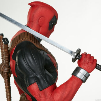 close up on sword in right arm of Deadpool Third Scale Statue