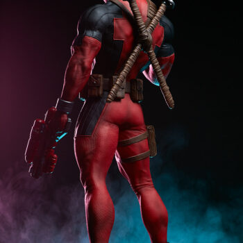back left side quarter view of Deadpool Third Scale Statue with pink and blue smoke statue